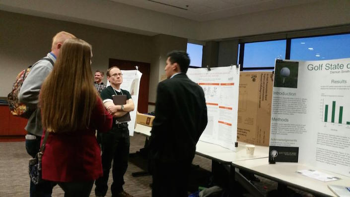 Dan presenting his poster at an undergraduate conference.