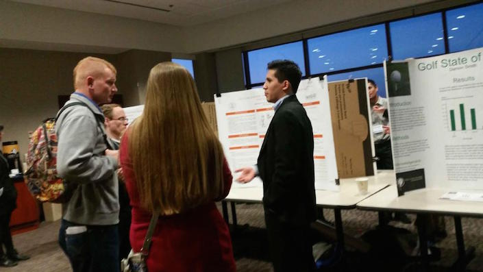 Dan discussing his poster at an undergraduate conference.
