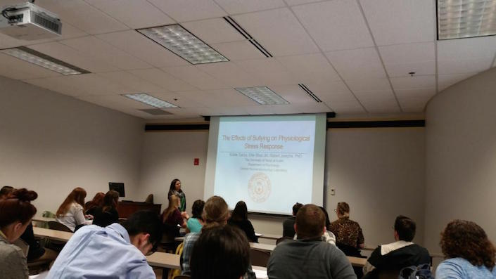 Kristie presenting her research at an undergraduate conference.