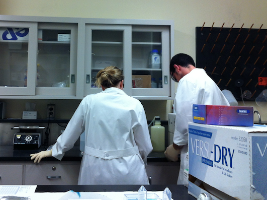 Leslie and Josh preparing the wash buffer solution.